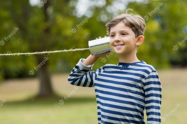 boy-listening-through-tin-can-phone_107420-35221.jpg